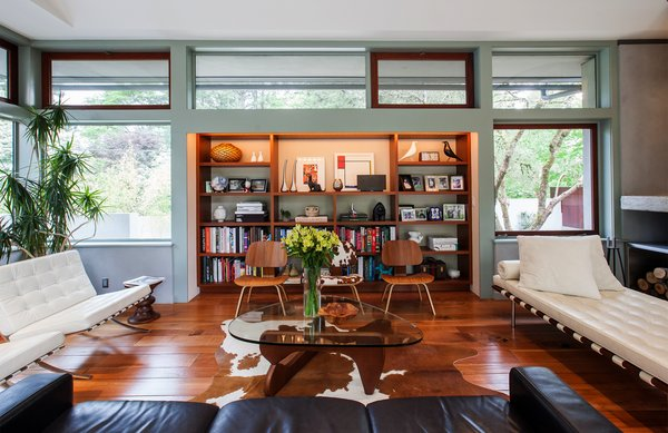 """Interior spaces feature Mahogany floors and casework. The thick walls, courtesy of the 12"""" Rastra Blocks, allow for deep storage niches. Photo 5 of Cedar Mills House modern home"""