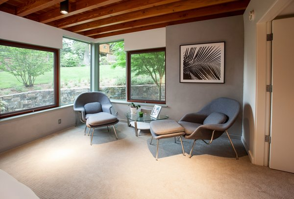 Exposed framing at the ceiling adds warmth to the Master Bedroom.   Photo 6 of Cedar Mills House modern home