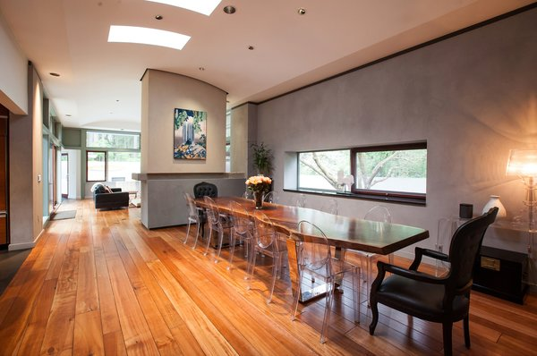 The Great Room features a barrel vaulted ceiling punctuated with several skylights.  Photo 8 of Cedar Mills House modern home