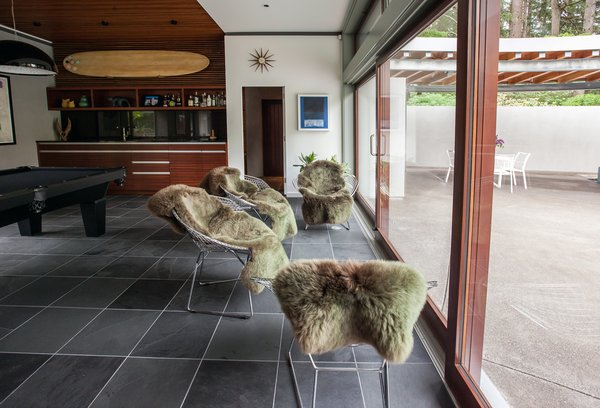 A series of full panel sliding glass doors open the family room to the pool terrace. Photo 11 of Cedar Mills House modern home