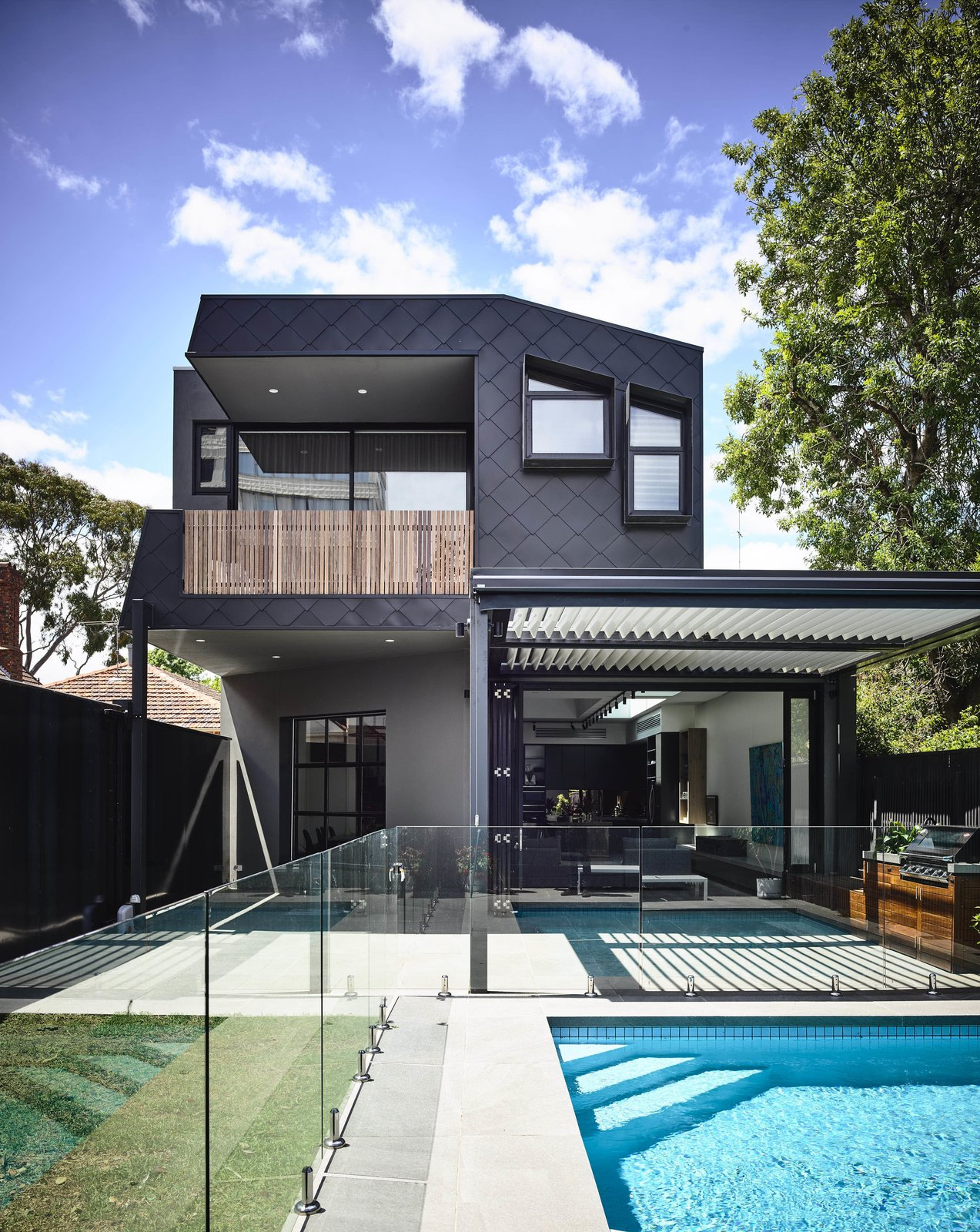 Tagged: Swimming Pools, Tubs, Shower, Grass, Large Pools, Tubs, Shower, Back Yard, Exterior, House, and Metal Siding Material.  Saint Kilda West by Ewert Leaf Pty Ltd