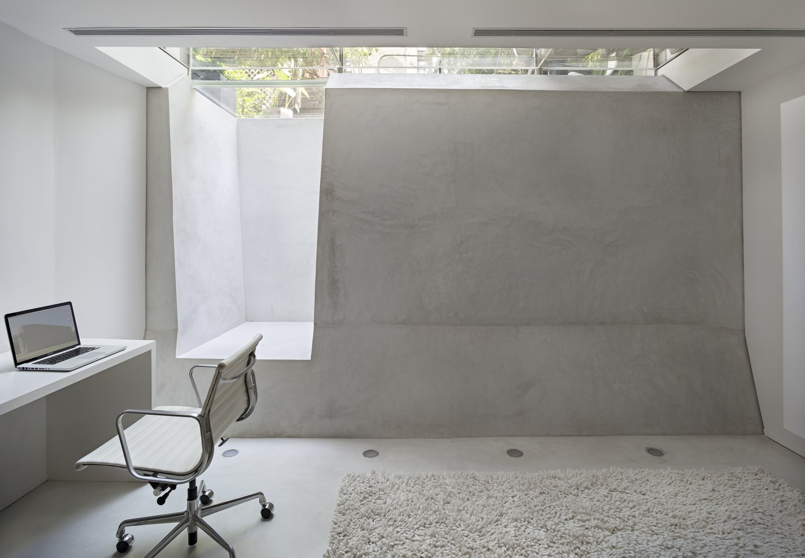 Tagged: Office, Study, Chair, and Concrete Floor.  Concrete Brooklyn Apartment by Brad Dickson
