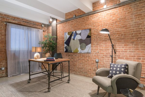 Private study with brick walls and industrial accents Photo 4 of Chelsea Loft modern home