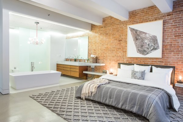 Master bed & bath with open view deep soaking tub  Photo 6 of Chelsea Loft modern home