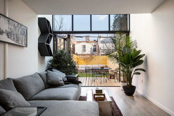 Folding glass doors open completely to deck and fenced back yard Photo 2 of Brooklyn Railroad Townhouse to Open Plan Renovation modern home