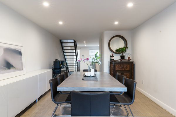 A first level bathroom nook was added off the dining room to serve guests on the main entertaining level Photo 5 of Brooklyn Railroad Townhouse to Open Plan Renovation modern home