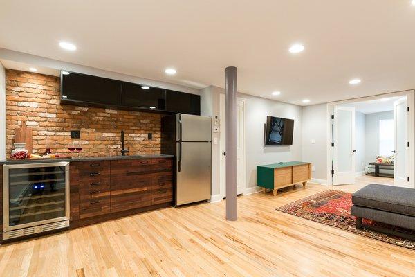 Wine fridge, wet bar, kitchen storage, and a full size fridge for entertaining Photo 2 of Jersey City Basement to Entertainment Renovation modern home
