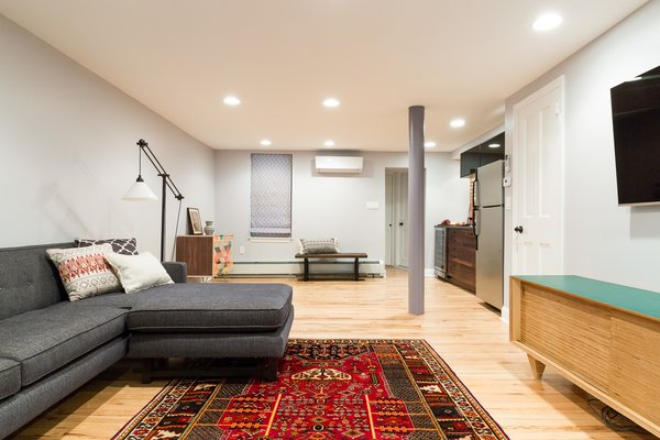 Open floor plan means refilling a glass doesn't take hosts out of the action Photo 3 of Jersey City Basement to Entertainment Renovation modern home