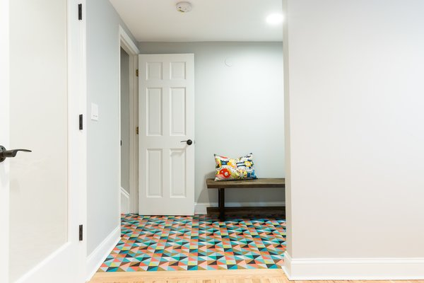Colorful entry floor to greet guests on the garden level entertaining space Photo 5 of Jersey City Basement to Entertainment Renovation modern home