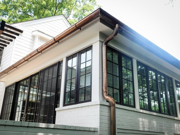 Modern home with casement window type, wood, folding door type, outdoor, exterior, and back yard. Photo 9 of The Biese Project