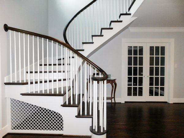 Modern home with staircase, wood tread, and wood railing. Photo 11 of The Biese Project