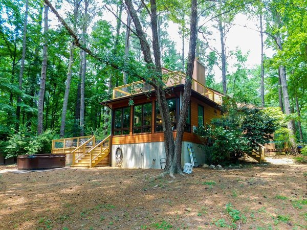 Modern home with outdoor, large patio, porch, deck, wood patio, porch, deck, wire fence, back yard, and decking patio, porch, deck. Photo 10 of The Ranheim Project