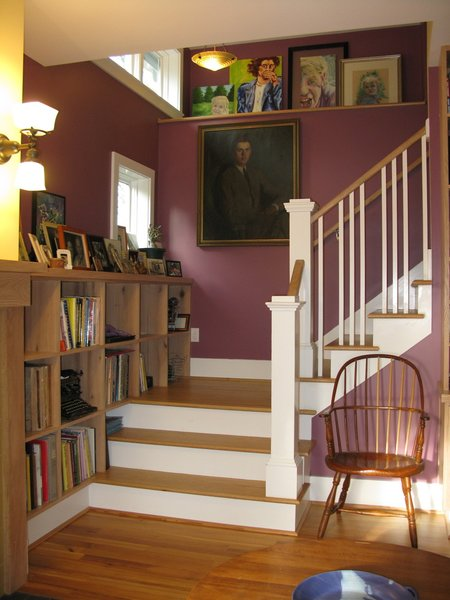 Modern home with staircase, wood railing, and wood tread. Stairwell Photo 6 of The McCullough Project