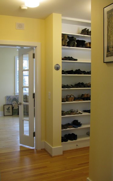 Modern home with storage room and shelves storage type. Rear Entry Shoe Shelves Photo 8 of The McCullough Project
