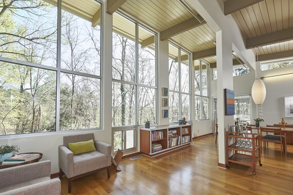 Modern home with bookcase, table, chair, shelves, track lighting, pendant lighting, windows, medium hardwood floor, picture window type, and metal. Photo 2 of The Alexander Project