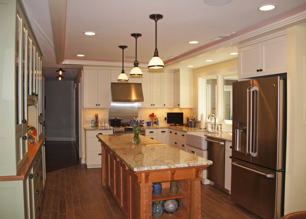 Modern home with kitchen, wood counter, white cabinet, stone counter, wood cabinet, medium hardwood floor, pendant lighting, recessed lighting, refrigerator, range, vessel sink, dishwasher, and range hood. Photo 2 of The Miller Project