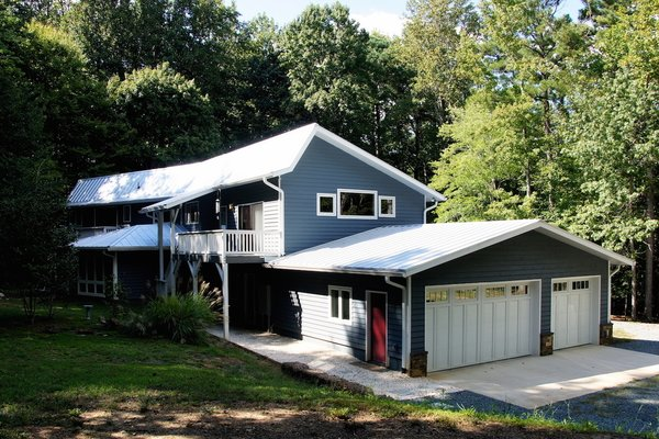 Modern home with outdoor, shrubs, wood patio, porch, deck, trees, small patio, porch, deck, and decking patio, porch, deck. Photo 11 of The Miller Project