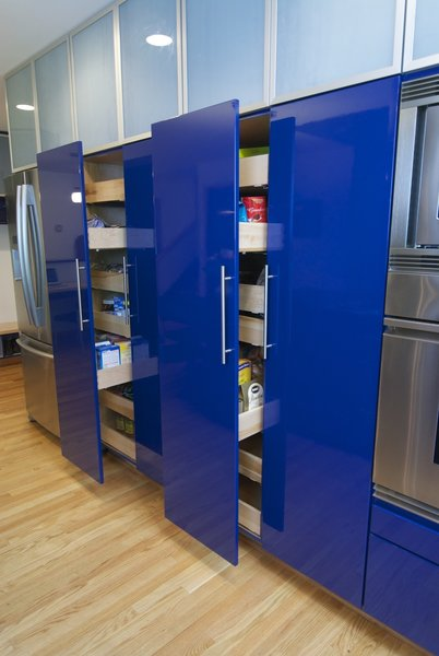 Modern home with wood cabinet, recessed lighting, light hardwood floor, colorful cabinet, wall oven, refrigerator, storage room, and cabinet storage type. Photo 8 of The Domino-Scotti Kitchen