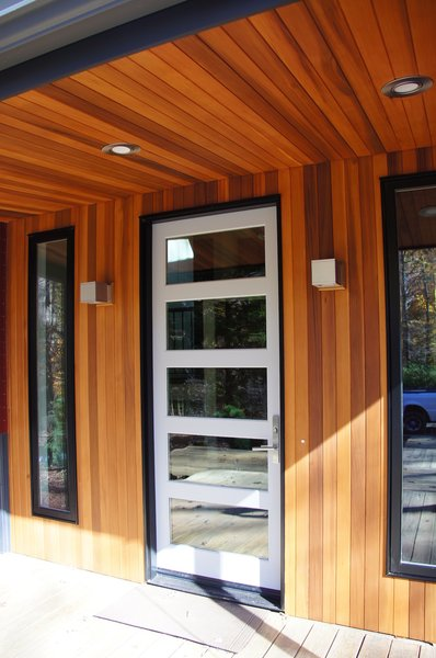 Modern home with wood, exterior, swing door type, windows, and picture window type. Front Entry Photo 3 of The Ross-Yarger Project