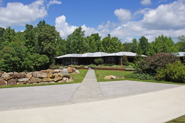 Modern home with outdoor, flowers, shrubs, grass, front yard, trees, boulders, walkways, raised planters, gardens, and landscape lighting. Photo 2 of The Holt-Bottomly Project