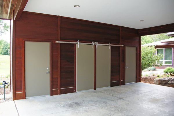 Modern home with closet storage type, storage space, doors, wood, exterior, metal, and sliding door type. Photo 5 of The Holt-Bottomly Project
