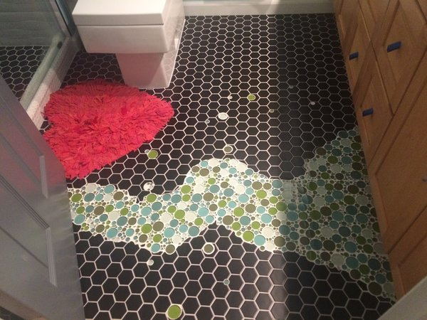 With the passion in bubbles the home owner/designer searched for bubbles tiles and installed them in the kids' bathroom floor with black hexagon tiles as background. Photo 3 of The Bubbles House modern home