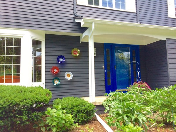 Dark gray exterior color with white trims make the house stand out in this colonial style residential neighborhood.  Glass wall art were made by Wolf Art Glass. Photo 18 of The Bubbles House modern home