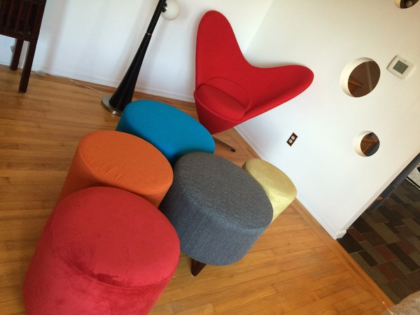 The designer used circle ottomans in different colors with different textures to add to the relatively large living room.  They add the dynamic to the living room space. Photo 6 of The Bubbles House modern home