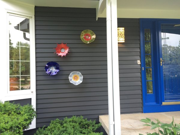 The colorful art glass highlights the front porch.  Created by Wolf Art Glass Photo 19 of The Bubbles House modern home