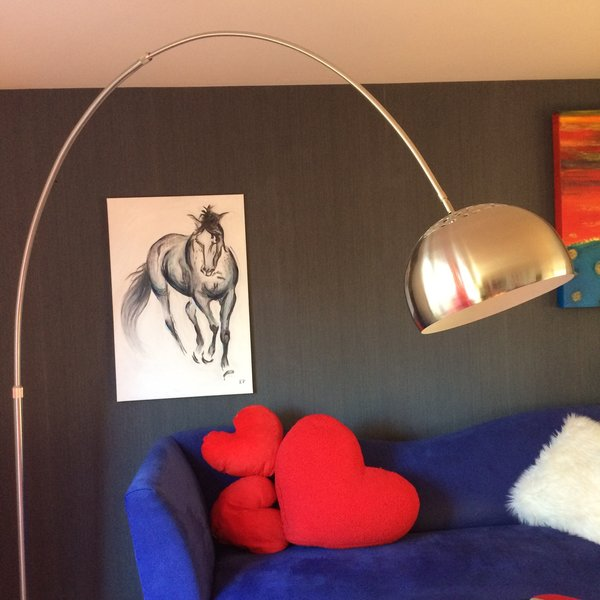 Both daughters are horse riders and have passion in horses.  This painting of a dapple gray horse is their be loved Thorough bred horse, River.   Photo  of The Bubbles House modern home