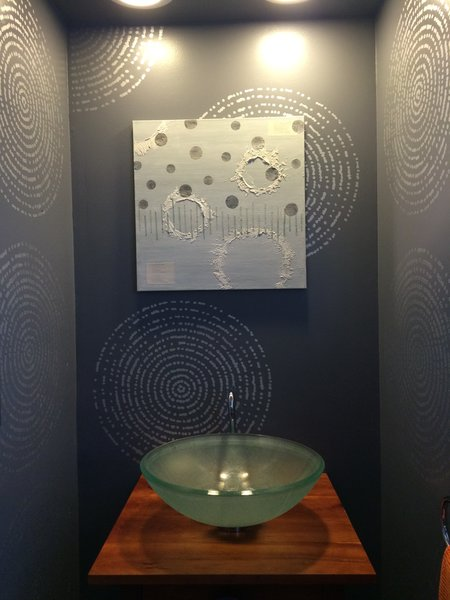 Powder room with dark gray wall and silver circle pattern make the small powder room seem big. Photo 15 of The Bubbles House modern home