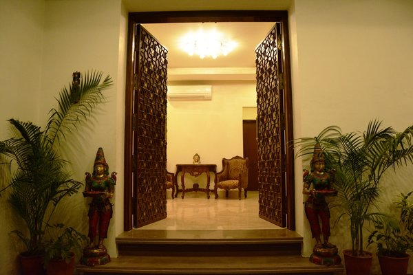 Entrance door having brass flowers and heavy wooden hand craving Photo 3 of SURAJ - BUNGALOW modern home