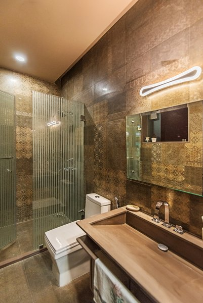 The toilet provides a relaxing aura and posses the earthy feel. Photo 4 of Textile Studio - Sapphire Fashions modern home