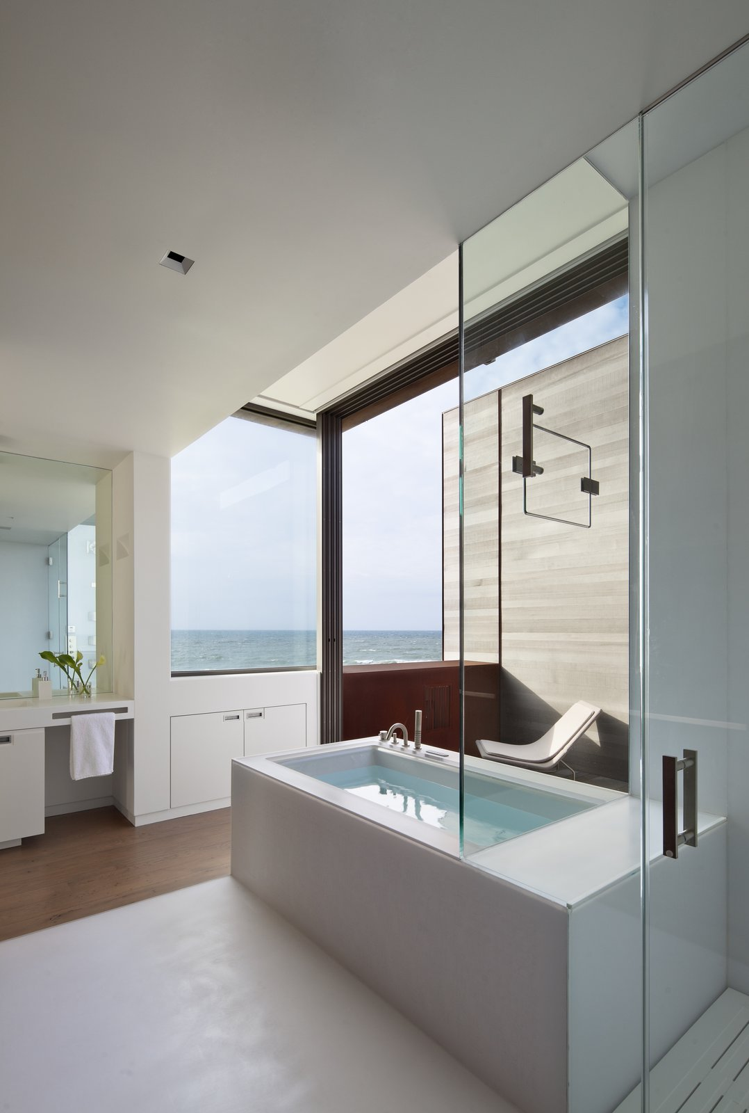 Tagged: Bath Room, Engineered Quartz Counter, Enclosed Shower, Medium Hardwood Floor, Soaking Tub, and Recessed Lighting.  Sagaponack, NY by The Corcoran Group