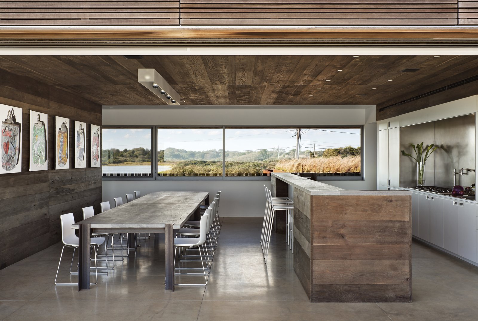Tagged: Bar, Kitchen, Concrete Counter, Concrete Backsplashe, Concrete Floor, White Cabinet, Ceiling Lighting, Recessed Lighting, Refrigerator, and Range.  Sagaponack, NY by The Corcoran Group