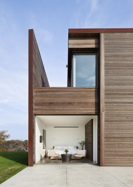 Modern home with bedroom, chair, recessed lighting, bed, accent lighting, and concrete floor. Photo 8 of Sagaponack, NY