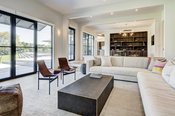 Living room with floor to ceiling windows.