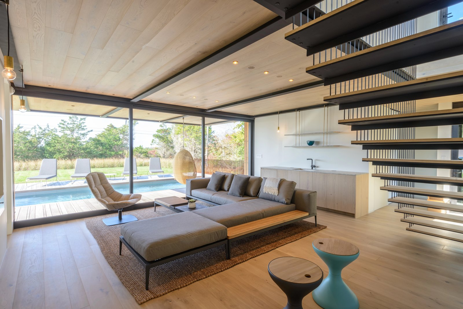 Tagged: Living Room, Bench, Sofa, Ottomans, Coffee Tables, Chair, Light Hardwood Floor, Ceiling Lighting, and Recessed Lighting. Amagansett Landmark by The Corcoran Group