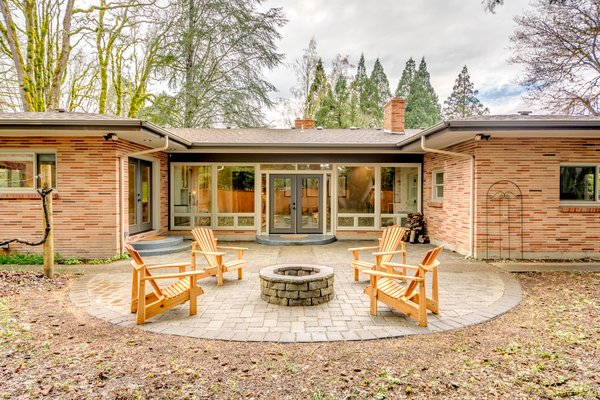 Handmade Adirondacks from local red cedar gather around the backyard fire pit. Photo 2 of Chic Mid-Century in Oregon Wine Country modern home