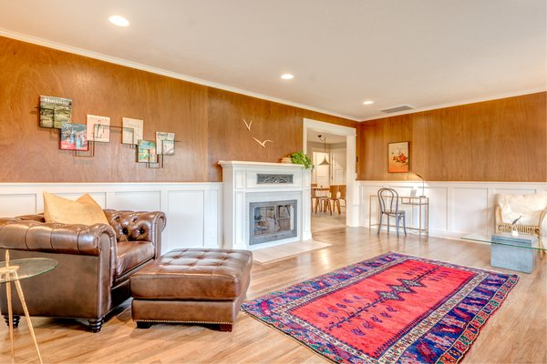 The entry room features a Turkish rug, leather club chair, two magazine racks from Roije (Amsterdam), and a gas fireplace. Photo 3 of Chic Mid-Century in Oregon Wine Country modern home