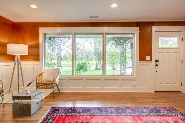 Entry room, with a concrete/glass coffee table from Urbia, faces the golf course across the street. Photo 4 of Chic Mid-Century in Oregon Wine Country modern home