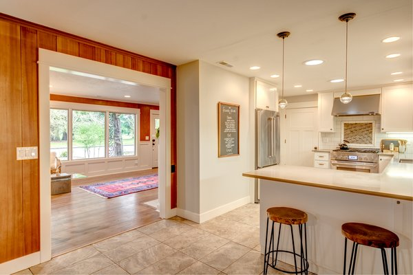 Entering the kitchen, featuring Jenn Air appliances. Photo 5 of Chic Mid-Century in Oregon Wine Country modern home