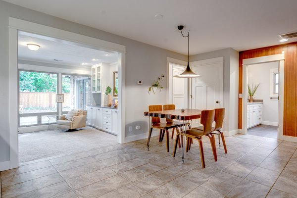 The dining area opens up to the living room, second bed and bath, TV room, and master bedroom. Photo 7 of Chic Mid-Century in Oregon Wine Country modern home
