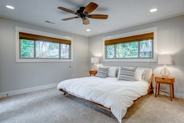 Master bedroom features a king-sized organic mattress and luxury bedding. Photo 10 of Chic Mid-Century in Oregon Wine Country modern home