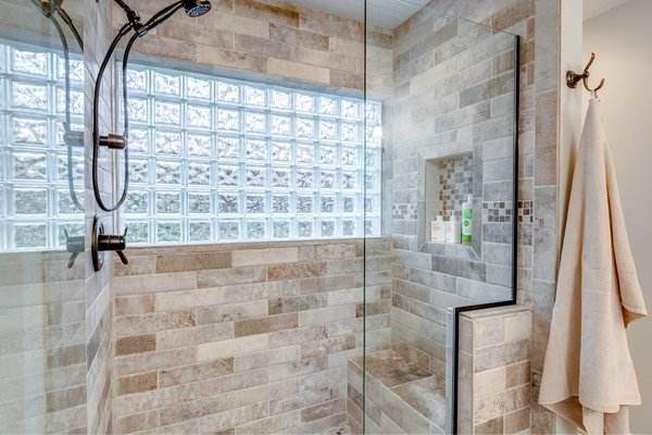 The master bathroom features a walk-in shower with rainfall shower head. Photo 12 of Chic Mid-Century in Oregon Wine Country modern home