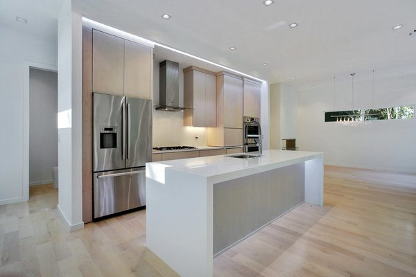 Lighting strips over the cabinets and under the island brighten up the space Photo 5 of 908 Kings Court modern home