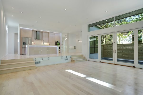 Huge patio doors open up the rom and glass panel stairs lead up to the kitchen. Photo 6 of 908 Kings Court modern home
