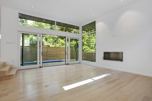Large Pella Windows and double sliding doors feature throughout Photo 7 of 908 Kings Court modern home