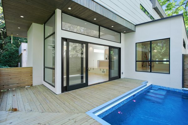 Wooden panelling and a private swimming pool Photo 9 of 908 Kings Court modern home