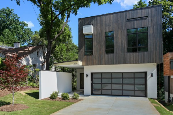 External shot of building showing TPO flat roof which doubles as a huge Rooftop deck and outdoor living space. Photo  of 908 Kings Court modern home